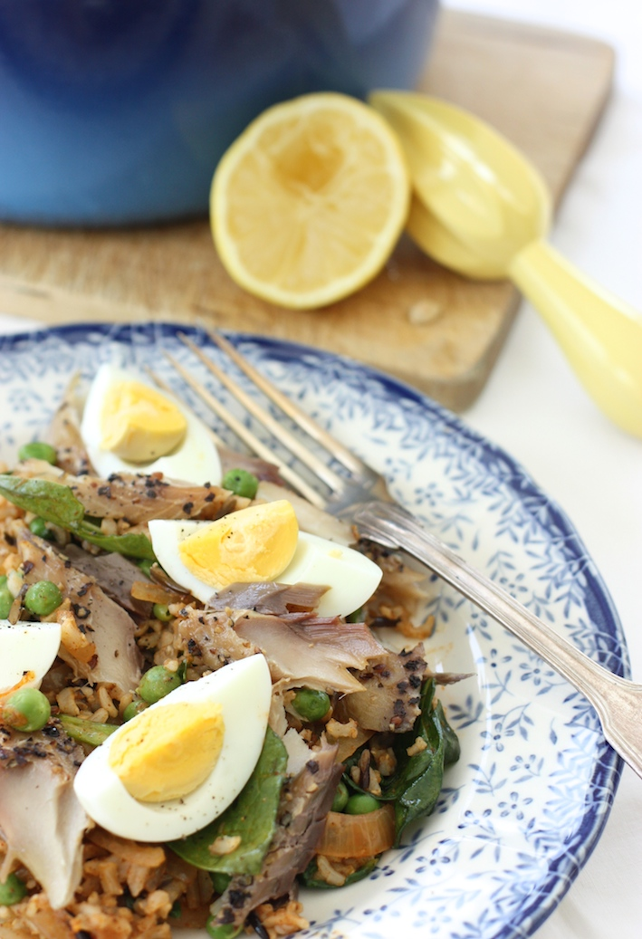 mackerel kedgeree on a blue and white plate with a silver fork