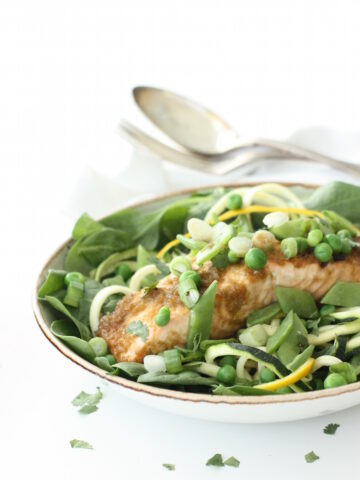 This Zesty Lime and Ginger Salmon is my current favourite healthy, speedy dinner. The salmon sits in an easy marinade for 10 minutes and is then baked in the oven. And that's the cooking part done. I sit the fish on a bed of leaves and spiralized courgettes with a few peas and some mangetout to sprinkle over the top. A light, fresh and zesty mid-week dinner that leaves me feeling full of energy and ready to tackle anything.