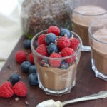 an Overnight Chocolate Chia Pudding that is deliciously velvety and creamy and has as much right at the breakfast table as it does for a sneaky after dinner treat. It's made with coconut milk (the drinking kind rather than the tinned kind) so it works if you need to avoid dairy PLUS the puddings also contain no refined sugar. And it's flexible too - we enjoyed it here topped with raspberries, blueberries and a sprinkle of cacao nibs, but it's also delicious with sliced bananas, greek yoghurt and a sprinkling of muesli; grapes, strawberries and pomegranate seeds