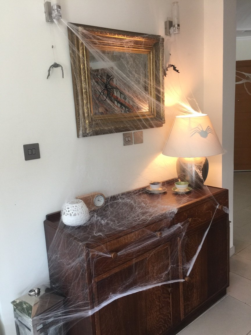 no fuss halloween party - cobwebs over the sideboard