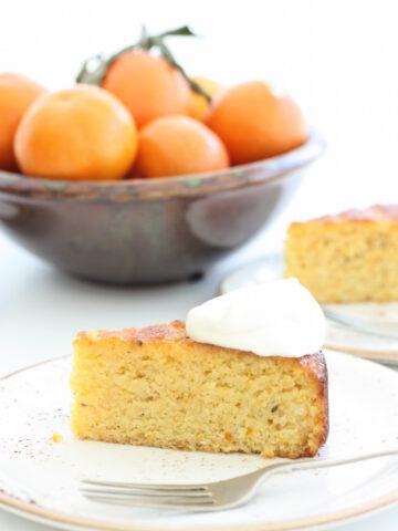 Sticky Clementine Cake - It's moist, it's zesty and it's completely delicious. Dessert worthy with a blob of crème fraîche but it's also perfect on its own.