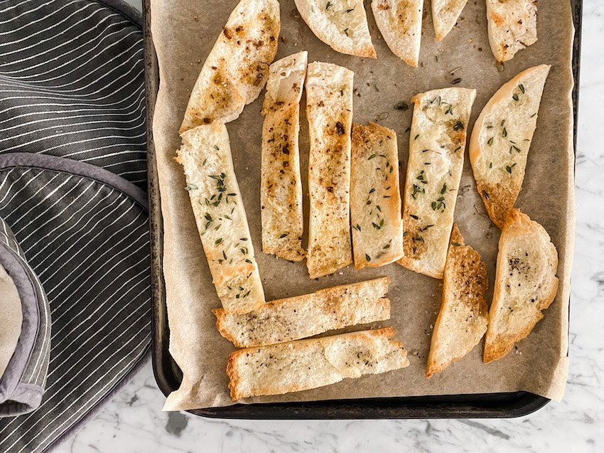 Pita Bread Crisps laid out on a baking tray