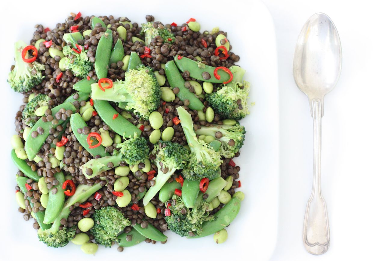 Puy Lentil Salad on a square white dish with a serving spoon