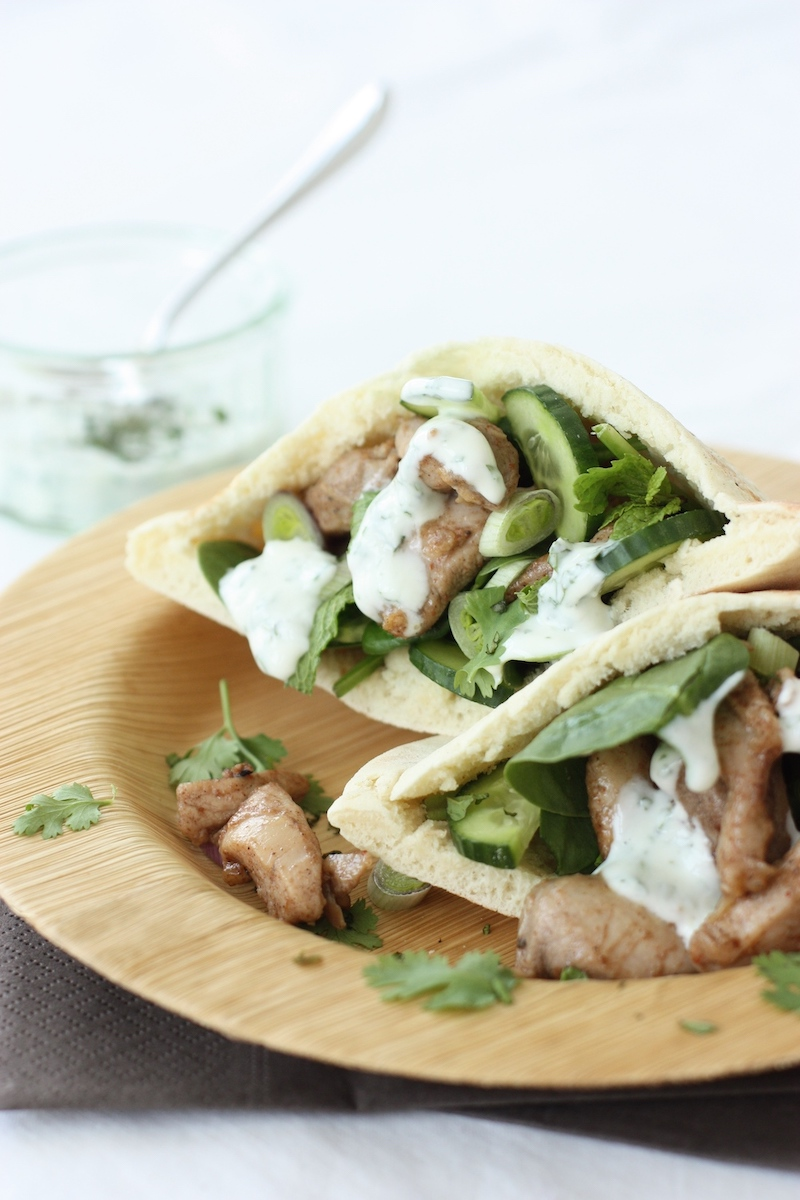 Baharat Chicken Flatbreads on a bamboo plate with a yoghurt dressing on the side