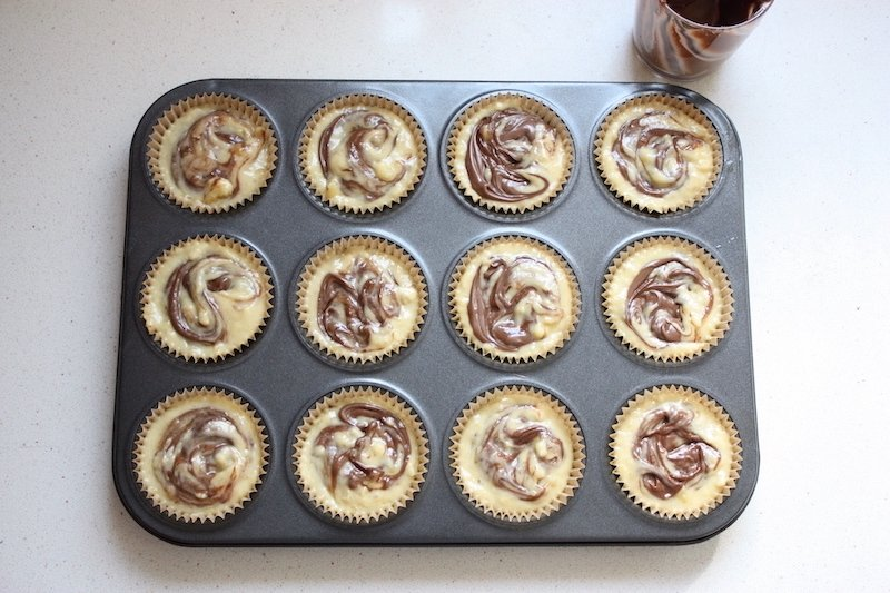 Nutella and Banana Muffins uncooked in a tray from above