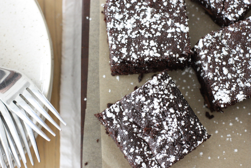 Chocolate brownies from above on a wooden board