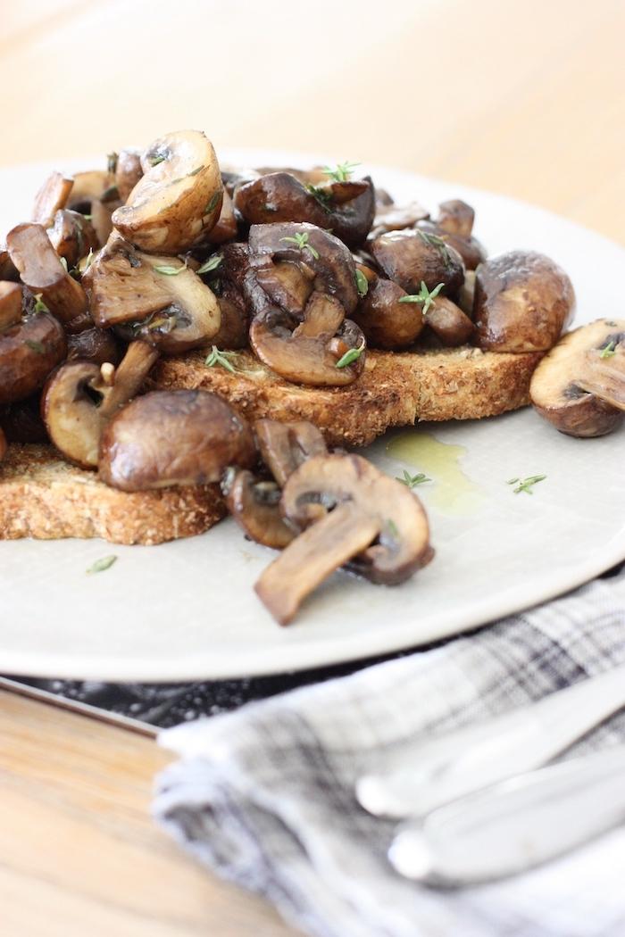 Mushrooms on toast on a white plate