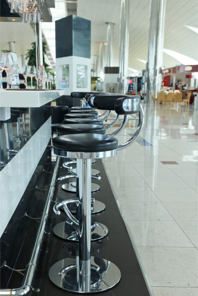 Airport lounge with black bar stools