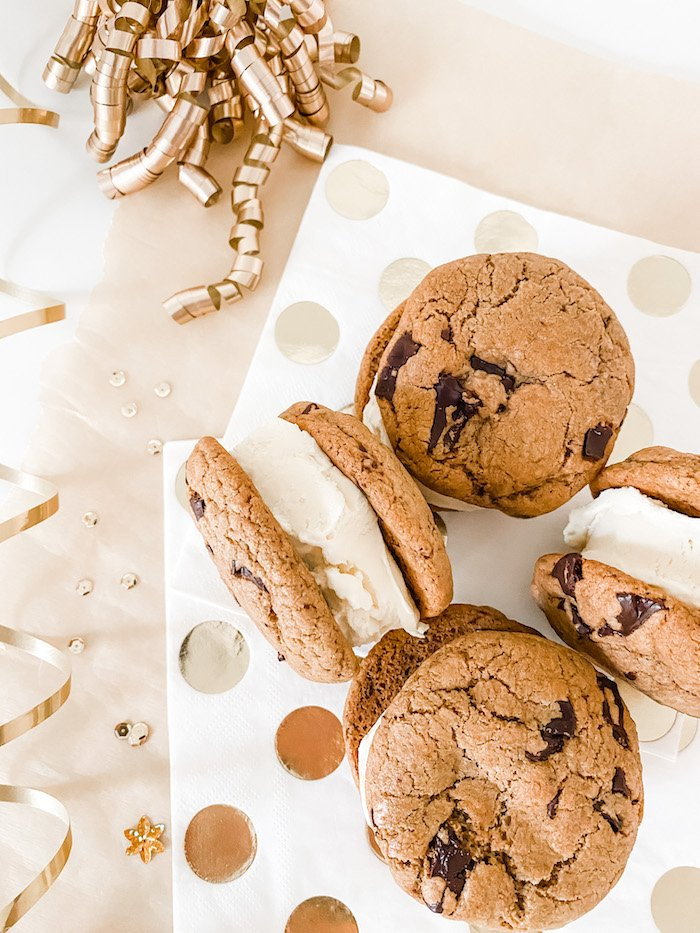 Ice cream sandwiches on a spotty napkin and surrounded by sparkles and ribbon
