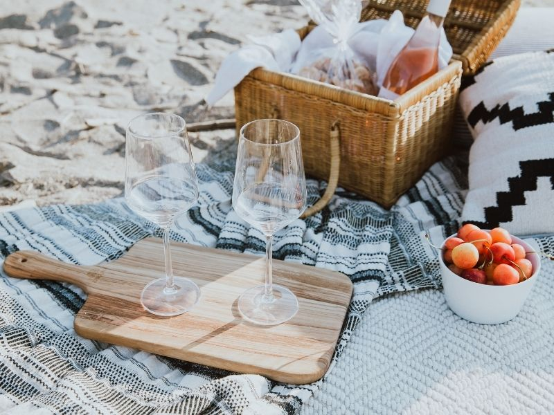 Picnic on the beach with two wine glasses