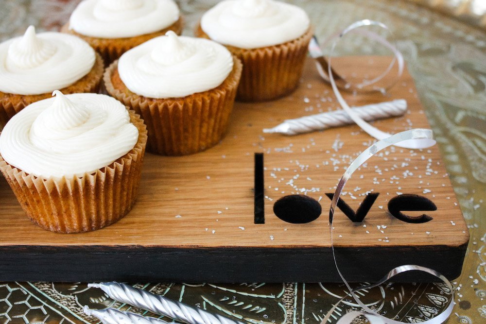Carrot Cakes on a wooden board with candles and ribbon
