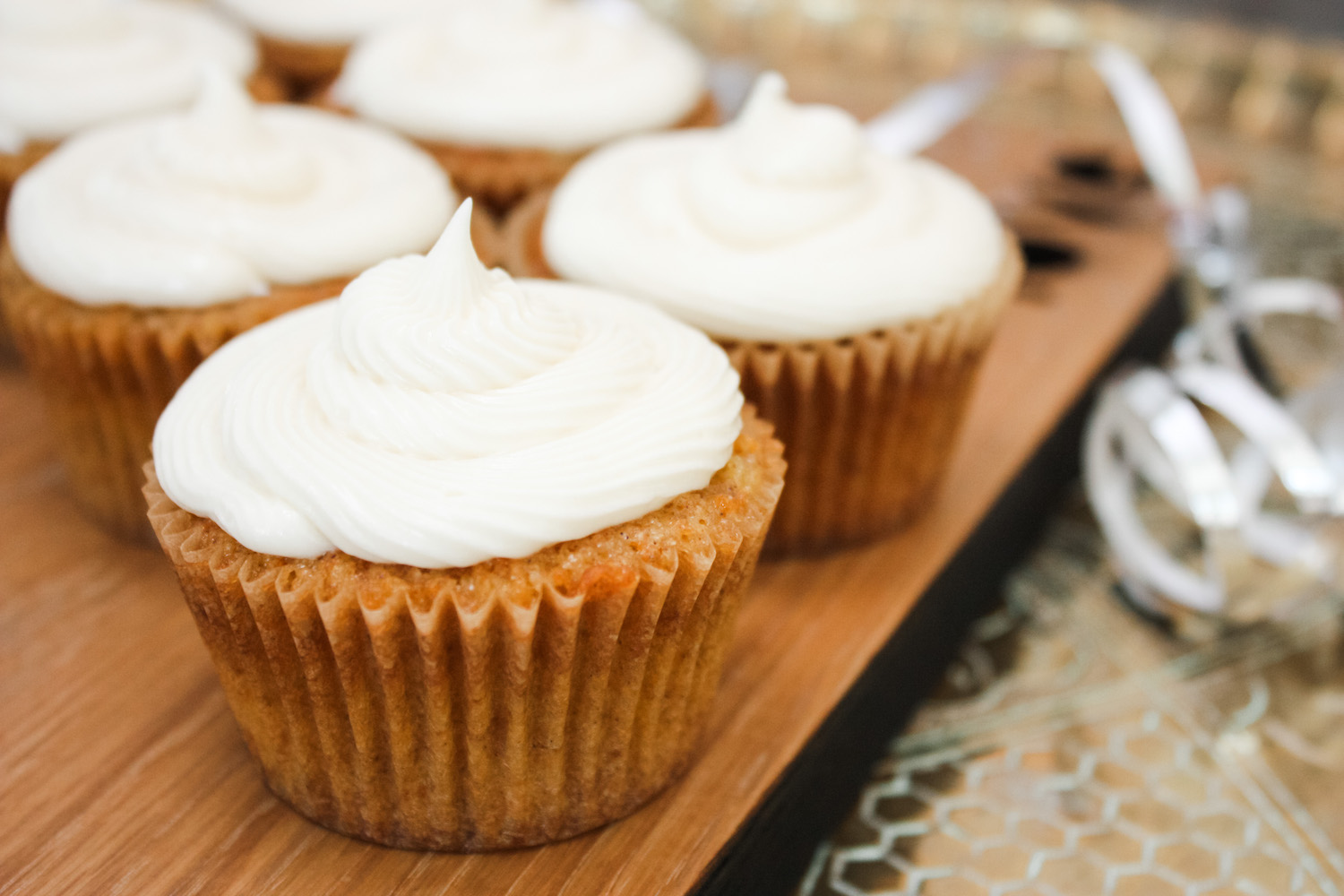 Carrot Cakes frosted and on a wooden board