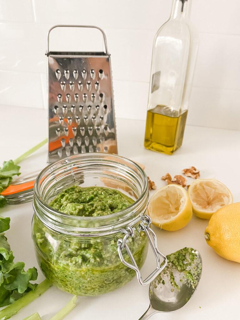 Kale Pesto in a jar with ingredients