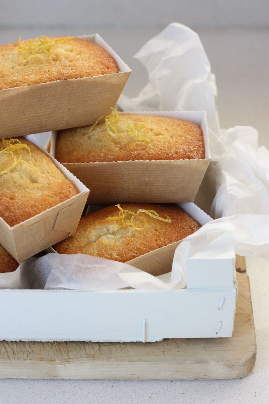 A pile of Mini Lemon Loaves in a white crate