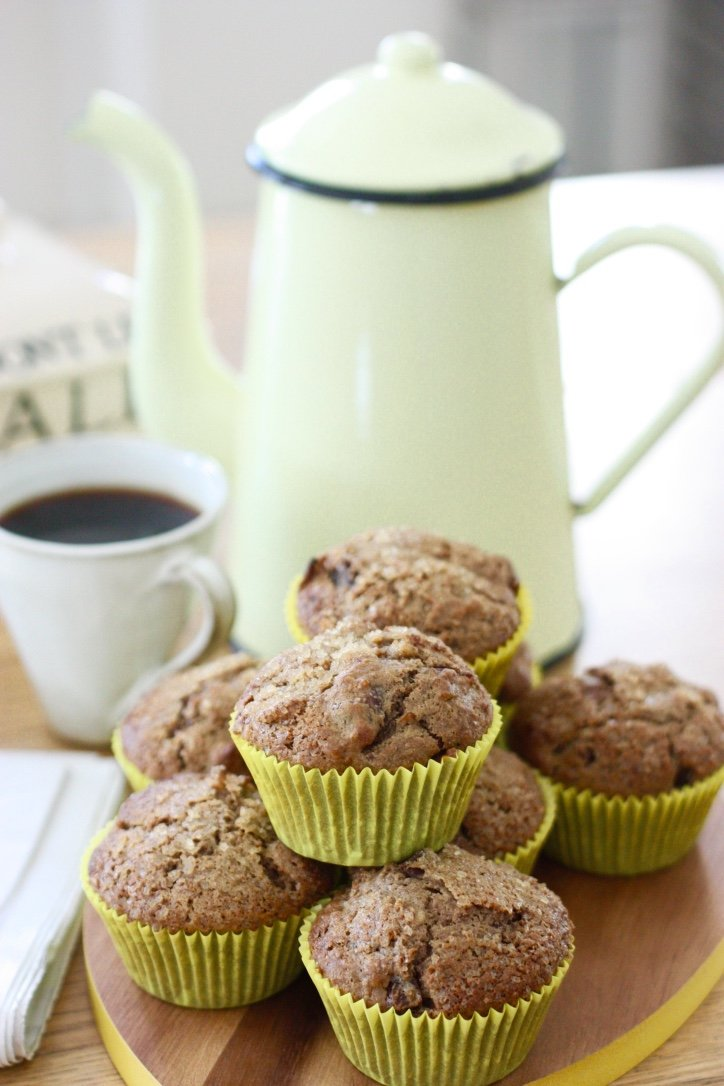Overnight Date and Granola Muffins in front of a pot of coffee