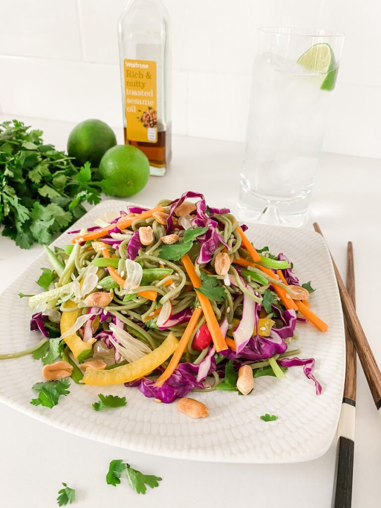 Thai Style Rainbow Noodle Salad on a white plate with chopsticks