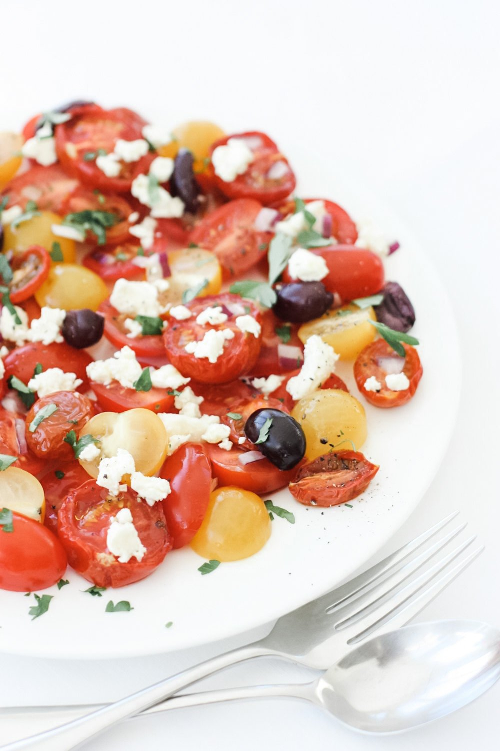 Roasted Tomato Salad served on a white plate
