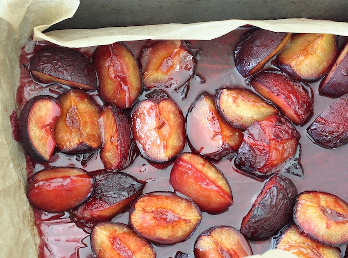 Roasted Plums with Vanilla Sugar baked in the tray with juices