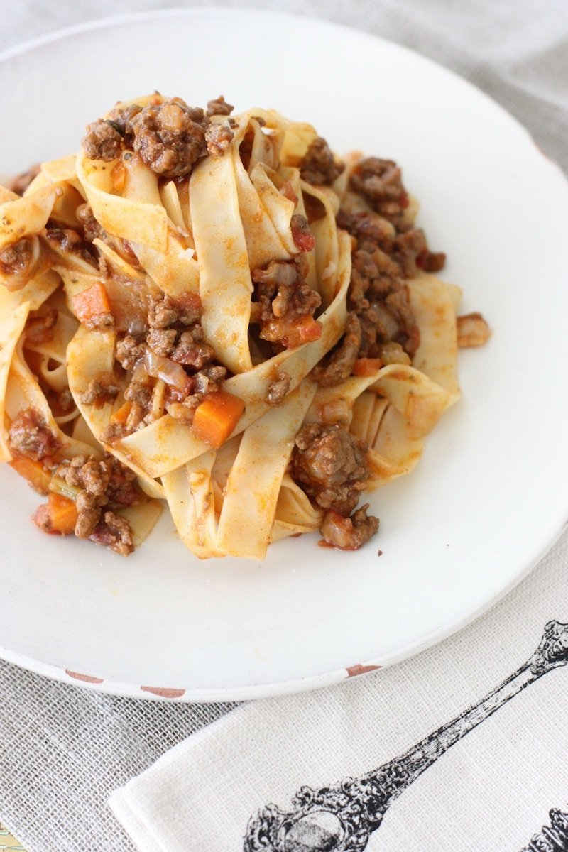 Bolognese sauce with pasta in a white dish