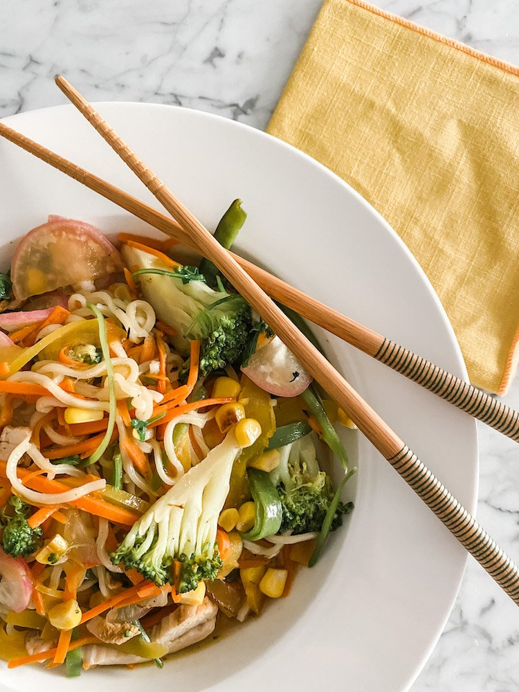Easy Peasy Chicken Noodles in a white dish with chopsticks