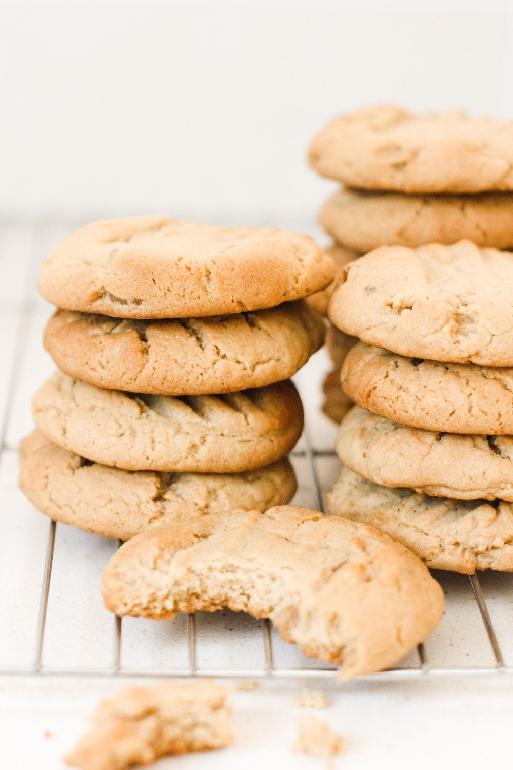 Piles of stem ginger cookies on a cooling rack