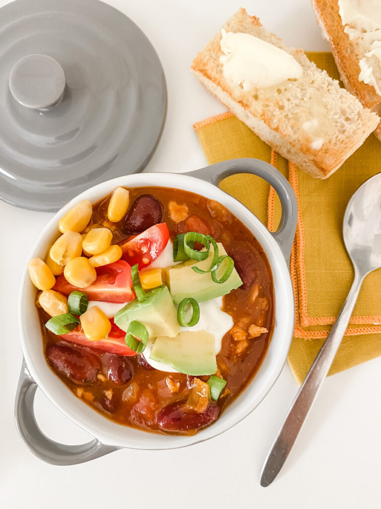 Turkey Chilli Soup in a small grey handled dish with toasted ciabatta